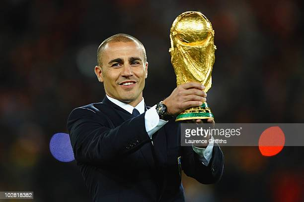 Fabio Cannavaro of Italy presents the World Cup trophy prior to the 2010 FIFA World Cup South Africa Final match between Netherlands and Spain at...