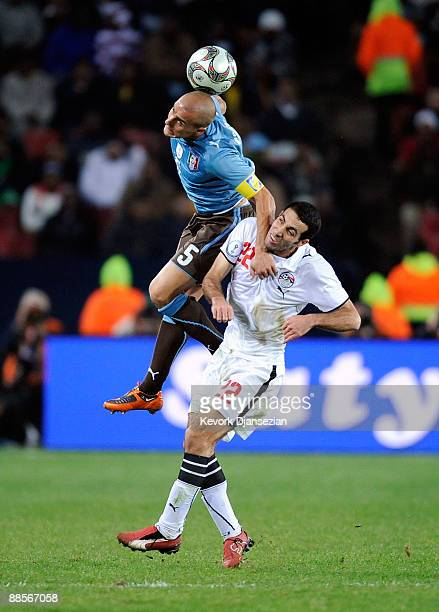 Fabio Cannavaro of Italy vies for the ball with Mohamed Aboutrika of Egypt during the FIFA Confederations Cup between Italy and Egypt at Ellis Park...