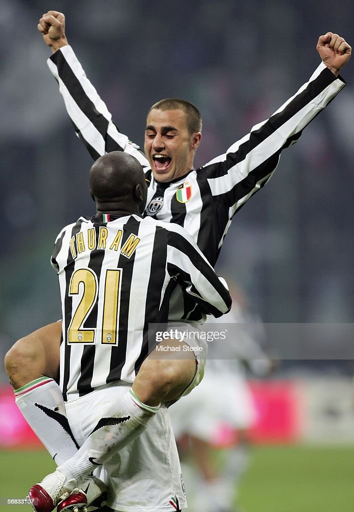 Fabio Cannavaro of Juventus celebrates his side's 2-1 victory at the final whistle with Liliam Thuram during the Serie A match between Inter Milan and Juventus at the Stadio San Siro on February 12, 2006 in Milan, Italy.