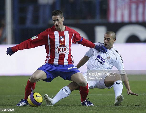 Fabio Cannavaro of Real Madrid tackles Fernando Torres of Atletico Madrid during the Jesus Gil Memorial friendly match between Atletico Madrid and...
