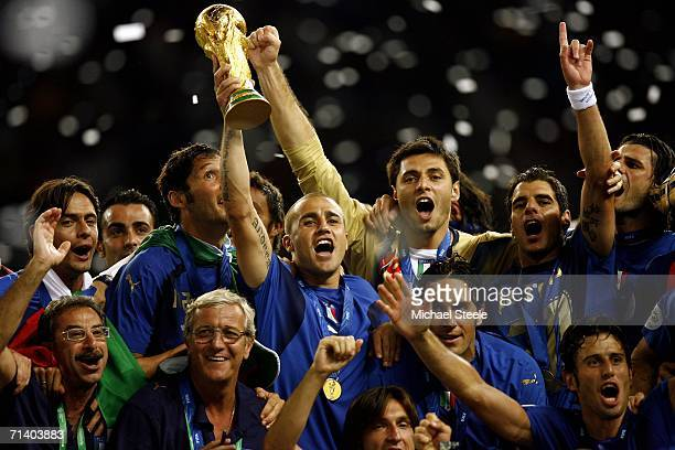 Fabio Cannavaro the captain of Italy celebrates with his team and coach following their victory during the FIFA World Cup Germany 2006 Final match...