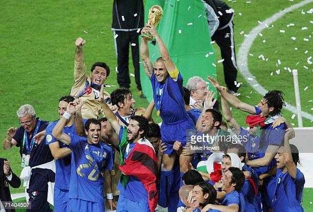 Fabio Cannavaro the captain of Italy lifts the world cup trophy after his team's victory during the FIFA World Cup Germany 2006 Final match between...