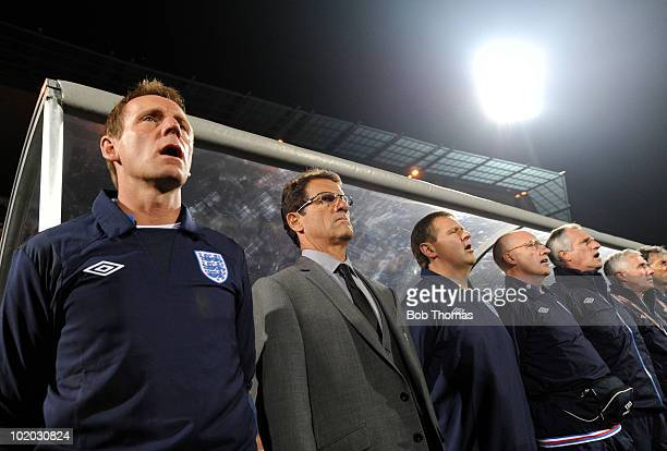 Fabio Capello coach of England and his assistant coach Stuart Pearce stand by their bench prior to the start of the 2010 FIFA World Cup South Africa...