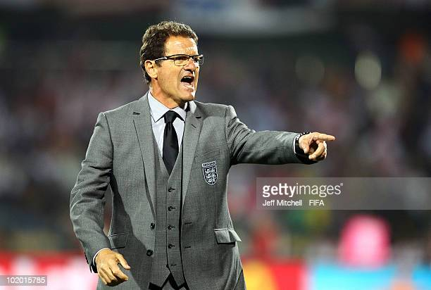Fabio Capello manager of England gives instructions to his players during the 2010 FIFA World Cup South Africa Group C match between England and USA...