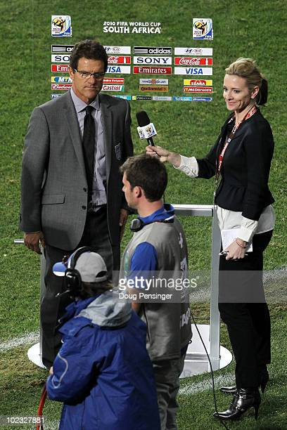 Fabio Capello manager of England is interviewed by TV presenter Gabby Logan after the 2010 FIFA World Cup South Africa Group C match between Slovenia...