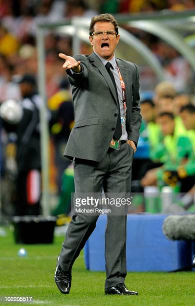 Fabio Capello manager of England shouts instructions to his players during the 2010 FIFA World Cup South Africa Group C match between England and...