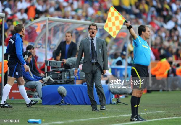 Fabio Capello manager of England shouts instructions to his team during the 2010 FIFA World Cup South Africa Round of Sixteen match between Germany...