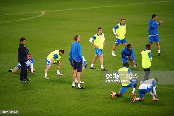 Fabio Capello of England ponders over his team selection during training ahead of their Group C match against Algeria at the Green Point Stadium on...