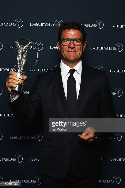 Fabio Capello poses with the trophy during the 2014 Laureus World Sports Awards at the Istana Budaya Theatre on March 26 2014 in Kuala Lumpur Malaysia
