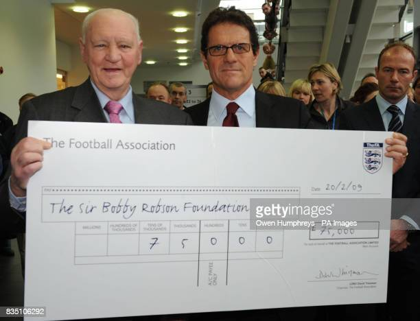 Fabio Capello presents Sir Bobby Robson with a 75000 cheque for The Sir Bobby Robson Foundation at the Northern Cancer Unit in the Freeman hospital...