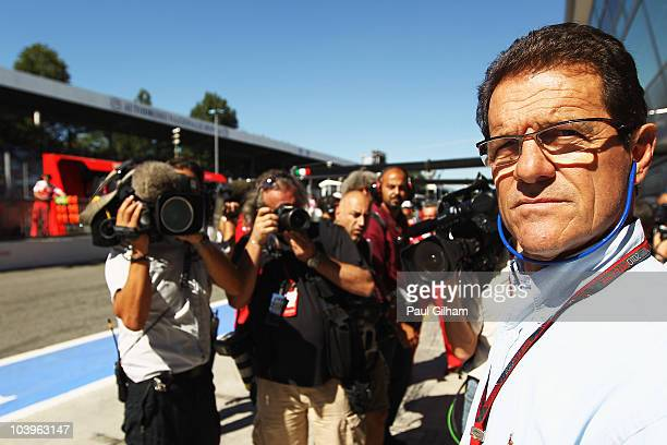 Fabio Capello the England football manager watches outside the Ferrari garage during practice for the Italian Formula One Grand Prix at the Autodromo...