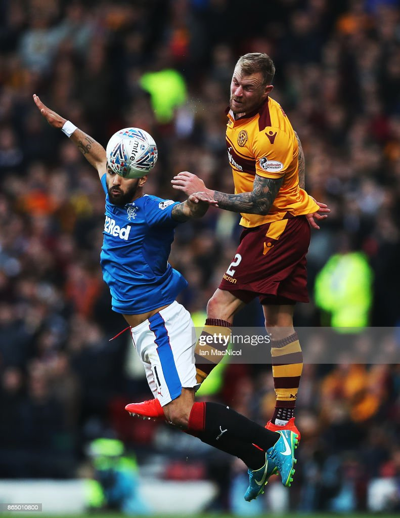 Fabio Cardoso of Rangers vies with Richard Tait of Motherwell during the Betfred League Cup Semi Final between Rangers and Motherwell at Hampden Park on October 22, 2017 in Glasgow, Scotland.