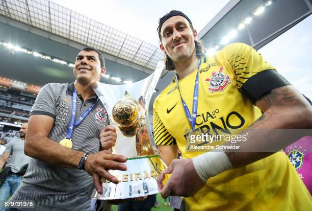 Fabio Carille and Cassio of Corinthians celebrate with the trophy after Corinthians win the Brasileirao 2017 after the match against Atletico MG for...
