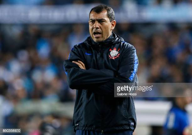 Fabio Carille coach of Corinthians gives instructions to his players during a second leg match between Racing Club and Corinthians as part of round...