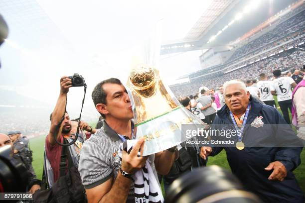 Fabio Carille of Corinthians celebrates with the trophy after Corinthians win the Brasileirao 2017 after the match against Atletico MG for the...