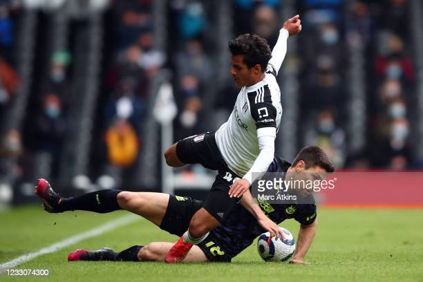 Fabio Carvalho of Fulham in action with Federico Fernadez of Newcastle United during the Premier League match between Fulham and Newcastle United at...