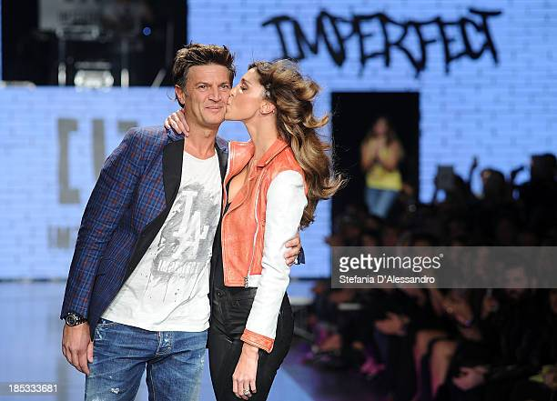 Fabio Castelli and Belen Rodriguez attend Imperfect Spring/Summer 2014 Fashion Show on October 18 2013 in Milan Italy