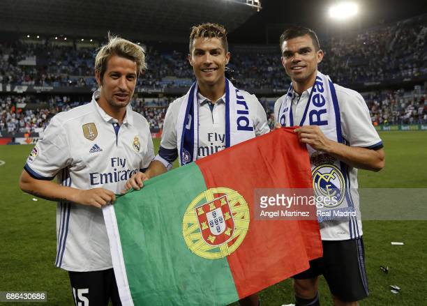 Fabio Coentrao Cristiano Ronaldo and Pepe of Real Madrid celebrate winning the La Liga title following the La Liga match between Malaga CF and Real...