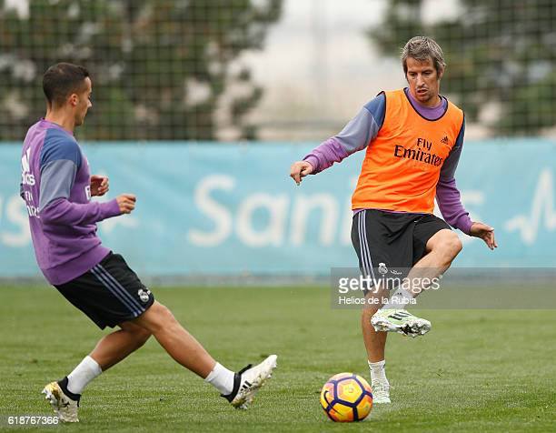 Fabio Coentrao Lucas Vazquez of Real Madrid warms up during a training session at Valdebebas training ground on October 28 2016 in Madrid Spain