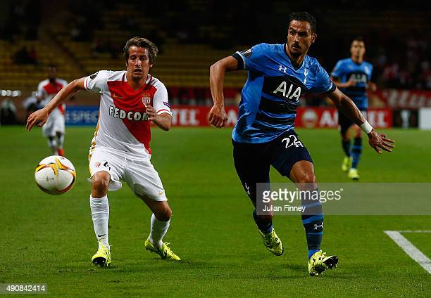 Fabio Coentrao of Monaco and Nacer Chadli of Tottenham Hotspur compete for the ball during the UEFA Europa League group J match between AS Monaco FC...