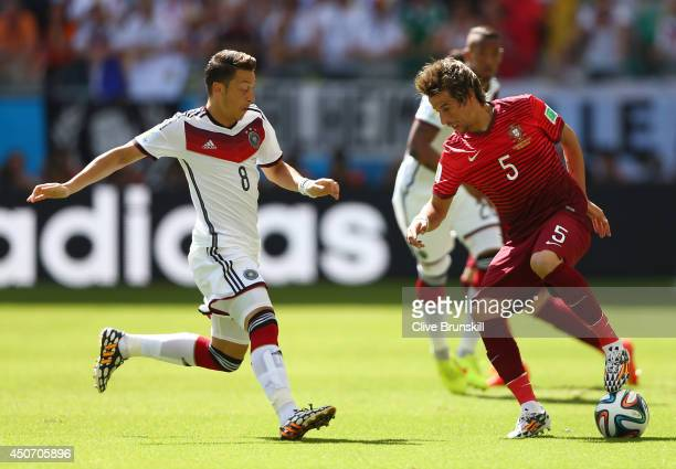 Fabio Coentrao of Portugal controls the ball against Mesut Oezil of Germany during the 2014 FIFA World Cup Brazil Group G match between Germany and...