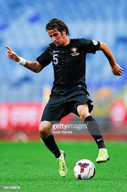 Fabio Coentrao of Portugal runs with the ball during the FIFA 2014 World Cup Qualifier match between Portugal and Luxembourg at Estadio Cidade de...