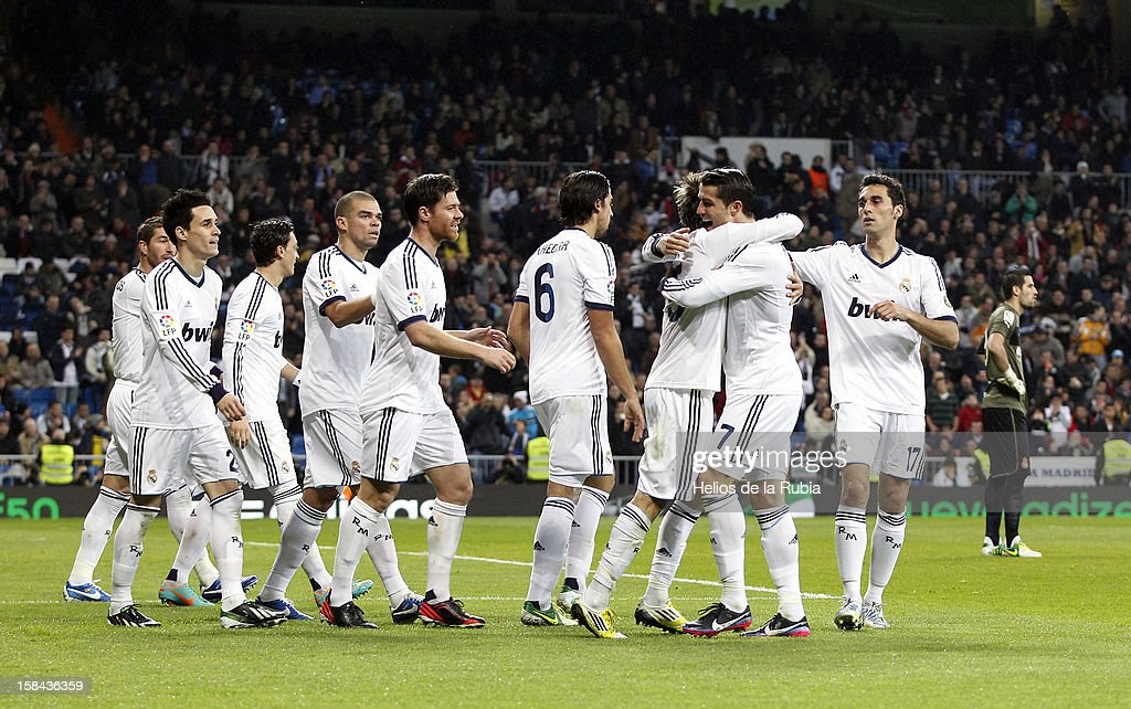 Fabio Coentrao of Real Madrid celebretes with his team mates after scoring during the La Liga match between Real Madrid and RCD Espanyol at Santiago Bernabeu stadium on December 16, 2012 in Madrid, Spain.