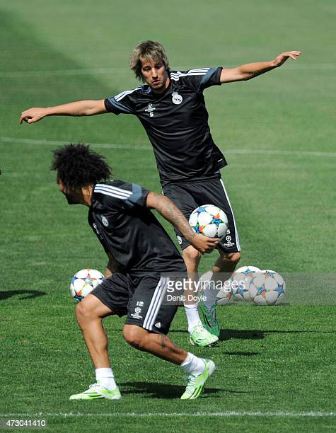 Fabio Coentrao of Real Madrid controls the ball beside Marcelo during the Real Madrid CF training session ahead of the UEFA Champions League Semi...