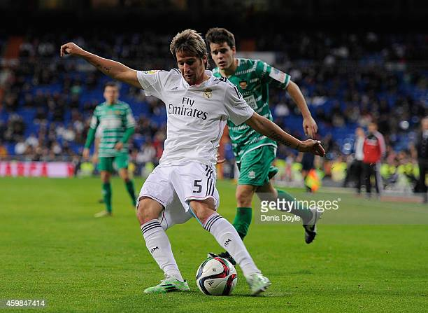 Fabio Coentrao of Real Madrid crosses the ball during the Copa Del Rey Round of 32 Second Leg match between Real Madrid CF and Cornella at Santiago...