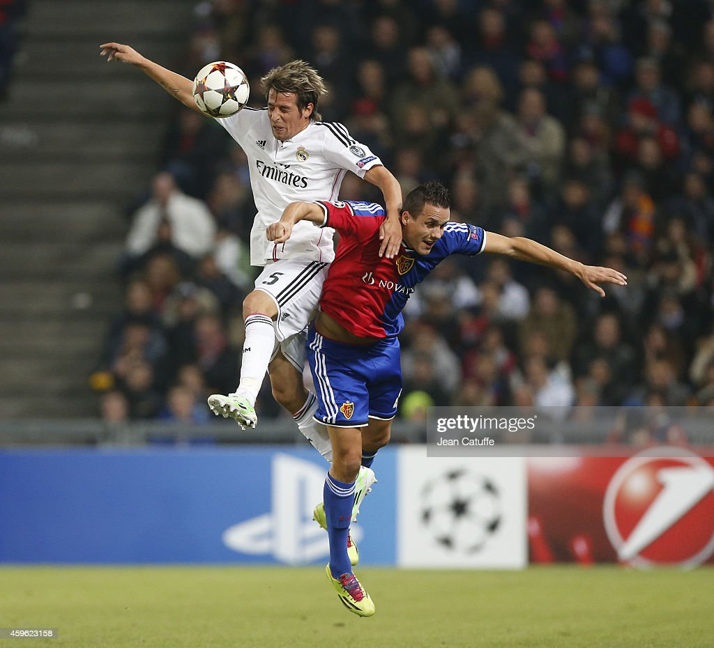 Fabio Coentrao of Real Madrid heads the ball over Philipp Degen of FC Basel during the UEFA Champions League Group B match between FC Basel 1893 and Real Madrid CF at St. Jakob-Park stadium on November 26, 2014 in Basel, Basel-Stadt, Switzerland.