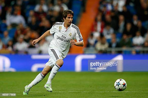 Fabio Coentrao of Real Madrid runs with the ball during the UEFA Champions League Round of 16 second leg match between Real Madrid CF and FC Schalke...