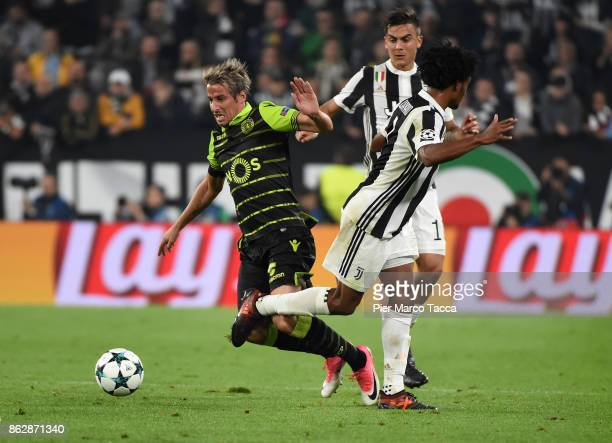 Fabio Coentrao of Sporting CP competes for the ball with Juan Cuadrado of Juventus during the UEFA Champions League group D match between Juventus...
