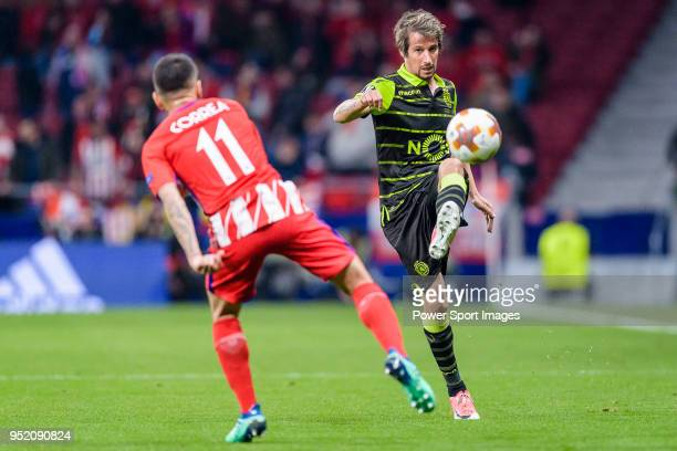 Fabio Coentrao of Sporting CP fights for the ball with Angel Correa of Atletico de Madrid during the UEFA Europa League quarter final leg one match...