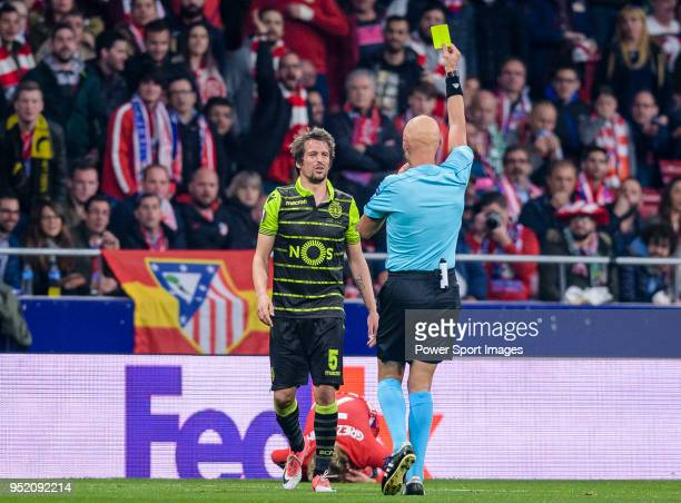 Fabio Coentrao of Sporting CP given a yellow card by referee Sergei Karasev during the UEFA Europa League quarter final leg one match between...