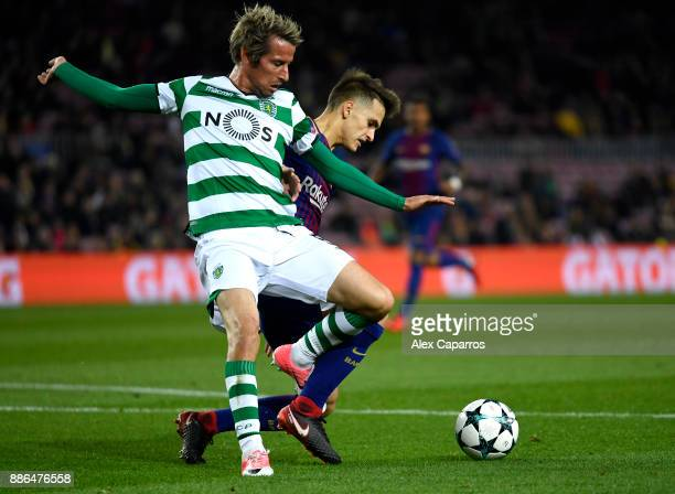 Fabio Coentrao of Sporting Lisbon is challenged by Denis Suarez of Barcelona during the UEFA Champions League group D match between FC Barcelona and...