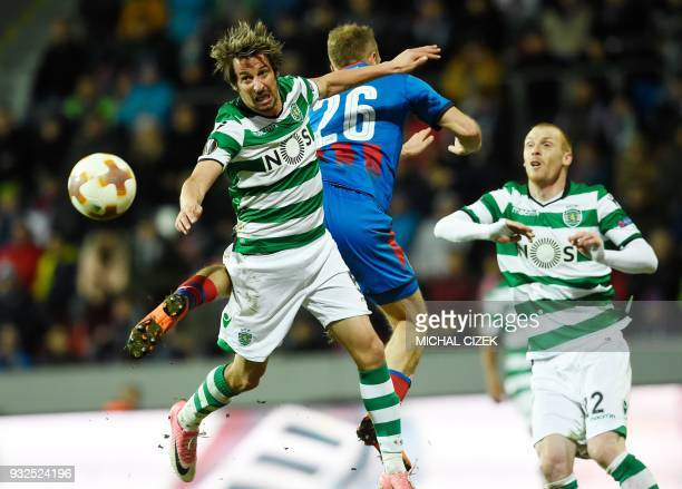 Fabio Coentrao of Sporting Lisbon vies for a ball with Daniel Kolar of Viktoria Plzen during the Europa League Round of 16 second leg football match...