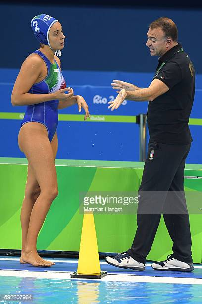 Fabio Conti coach of Italy talks to Chiara Tabani of Italy during the Women's Water Polo Gold Medal match between the United States and Italy on Day...