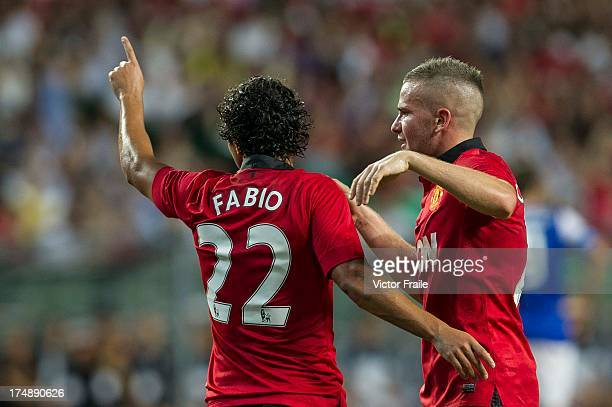 Fabio da Silva of Manchester United celebrates his goal with team mate Tom Cleverley during the international friendly match between Kitchee FC and...