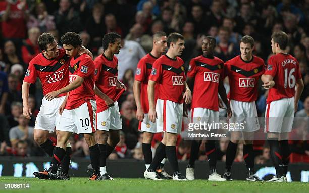 Fabio Da Silva of Manchester United is consoled by Gary Neville after being sent off during the Carling Cup Third Round match between Manchester...