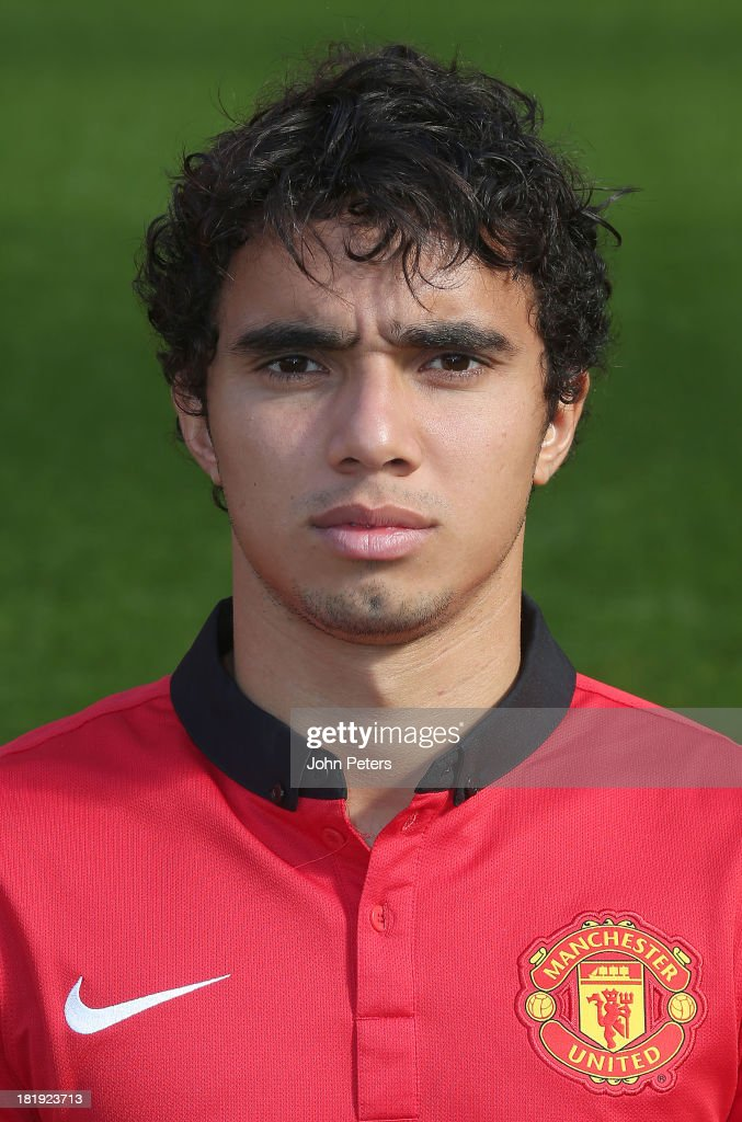 Fabio da Silva of Manchester United poses at the annual club photocall at Old Trafford on September 26, 2013 in Manchester, England.