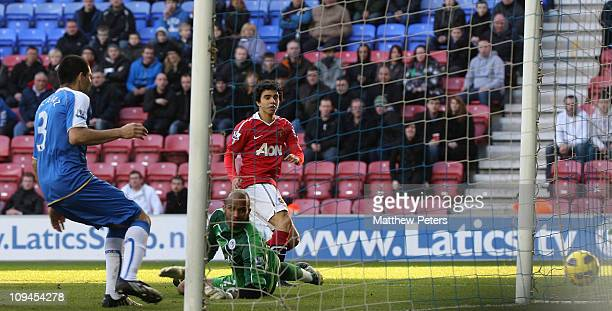 Fabio Da Silva of Manchester United scores their fourth goal during the Barclays Premier League match between Wigan Athletic and Manchester United at...