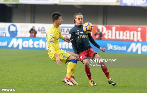Fabio Depaoli of Chievo Verona competes with Diego Laxalt of Genoa during the serie A match between AC Chievo Verona and Genoa CFC at Stadio...