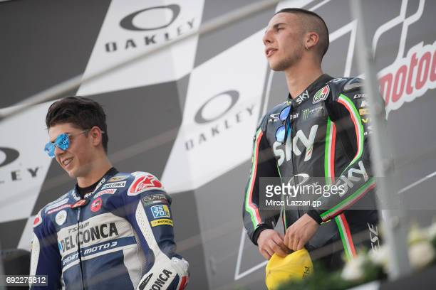 Fabio Di Giannantonio of Italy and Del Conca Gresini Moto3 Andrea Migno of Italy and Sky Racing Team VR46 celebrate on the podium at the end of the...
