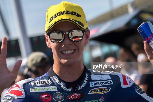 Fabio Di Giannantonio of Italy and Del Conca Gresini Moto3 celebrates the third place under the podium at the end of the Moto3 race during the MotoGP...