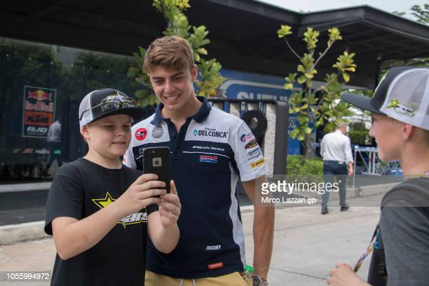 Fabio Di Giannantonio of Italy and Del Conca Gresini Moto3 poses for fans in paddock during the MotoGP Of Malaysia Previews at Sepang Circuit on...