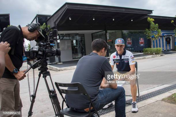 Fabio Di Giannantonio of Italy and Del Conca Gresini Moto3 speaks with journalists in paddock during the MotoGP Of Malaysia Previews at Sepang...