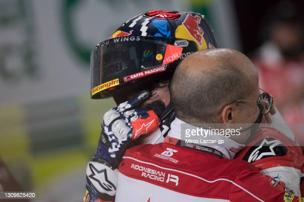 Fabio Di Giannantonio of Italy and Federal Oil Gresini Moto2 celebrates the third place and remembers Fausto Gresini of Italy with Carlo Merlini of...