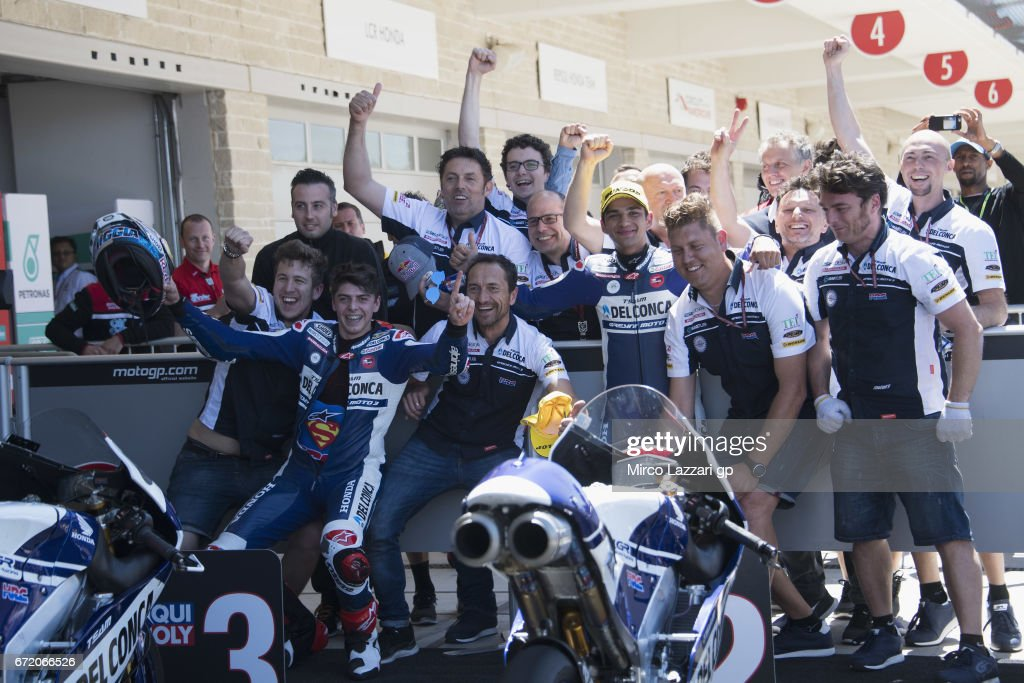 Fabio Di Giwnnantonio of Italy and Del Conca Gresini Moto3 (L) and Jorge Martin of Spain and Del Conca Gresini Moto3 celebrate with team under the podium at the end of the Moto3 race during the MotoGp Red Bull U.S. Grand Prix of The Americas - Race at Circuit of The Americas on April 23, 2017 in Austin, Texas.