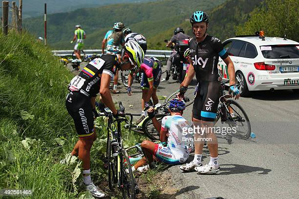 Fabio Duarte of Colombia and Team Colombia and Salvatore Puccio of Italy and Team SKY gather themselves after a crash during the eleventh stage of...