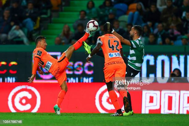 Fabio Espinho of Boavista FC vies with Bruno Fernandes of Sporting CP for the ball possession during the Liga NOS round 8 match between Sporting CP...